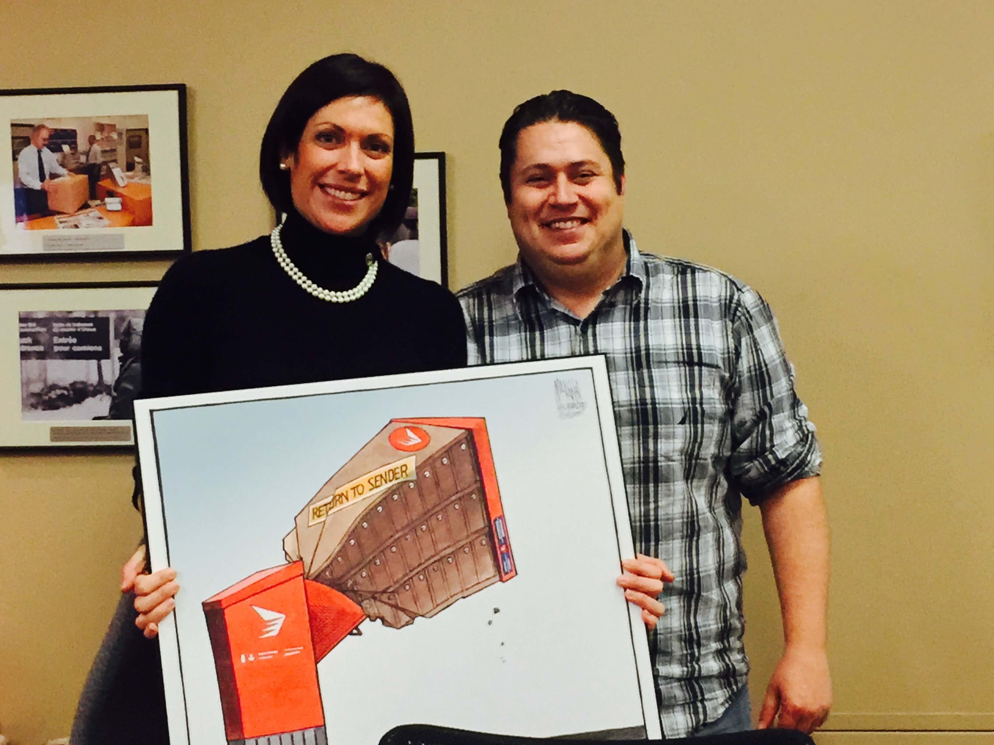 Presenting Karine Trudel with the 'Return to Sender' post-election CMB cartoon from the Chronicle-Herald
